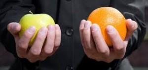 holding apple and orange